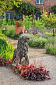 THE WALLED GARDEN AT COWDRAY, WEST SUSSEX: GRAVEL PATH, BORDERS, LION STATUE, HEUCHERA, ENGLISH, COUNTRY, GARDENS, SUMMER