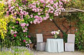 THE WALLED GARDEN AT COWDRAY, WEST SUSSEX: ROSE ARBOUR, TABLE, CHAIRS, PLACE TO SIT, AL FRESCO, DINING, ENGLISH, COUNTRY, GARDEN