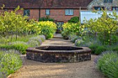 THE WALLED GARDEN AT COWDRAY, WEST SUSSEX: ENGLISH, COUNTRY, GARDEN, BORDERS OF LAVENDER, RAISED BRICK POOL, POND, WATER FEATURE, THALICTRUM GLAUCUM, PATHS