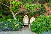 THE WALLED GARDEN AT COWDRAY, WEST SUSSEX: PLACE TO SIT, CATALPA, WOODEN BENCH, SEAT, SHADE, SHADY