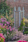 WYNYARD HALL, COUNTY DURHAM: ROSES , WOODEN TRELLIS SUPPORTS, WALL, WALLED ROSE GARDEN, SUMMER, JUNE, ROSA MORTIMER SACKLER