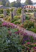 WYNYARD HALL, COUNTY DURHAM: WALLED ROSE GARDEN. WOODEN TRELLIS, ROSES, BORDERS, CARDOON, GRAVEL, PATHS, SUMMER, JUNE