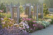 WYNYARD HALL, COUNTY DURHAM: WALLED ROSE GARDEN. WOODEN TRELLIS, ROSES, BORDERS, GRAVEL, PATHS, SUMMER, JUNE