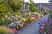 WYNYARD HALL, COUNTY DURHAM: WALLED ROSE GARDEN. BORDERS, SUMMER, JUNE, ROSES, PATHS, WOODEN, TRELLIS, SUPPORTS