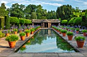 HAMPTON COURT CASTLE, HEREFORDSHIRE: THE DUTCH GARDEN - TERRACOTTA CONTAINERS OF BLUE AGAPANTHUS BESIDE CANAL, POND, POOL, WATER, SUMMER, BULBS, JULY, BUILDINGS, SUMMERHOUSES