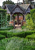 HAMPTON COURT CASTLE, HEREFORDSHIRE: PAVILION IN THE SOUTH GARDEN: BOX HEDGES, HEDGING, LAVENDER, CARDOONS, BUILDINGS, SUMMERHOUSES, STRUCTURES