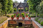 HAMPTON COURT CASTLE, HEREFORDSHIRE: PAVILION IN THE SOUTH GARDEN: BOX HEDGES, HEDGING, LAVENDER, BUILDINGS, SUMMERHOUSES, STRUCTURES, WATER, CANAL
