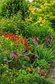 MORTON HALL GARDENS, WORCESTERSHIRE: KITCHEN GARDEN, BORDERS WITH RICINUS COMMUNIS, HELENIUM INDIAN SUMMER, LILIUM HENRYI, JULY, BORDERS, KITCHEN, PATHS