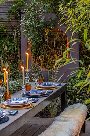 TANYA_SOUTHWORTH_GARDEN_LONDON_DESIGNER_ANOUSHKA_FEILER_SMALL_GARDEN__TABLE_BENCHES_CANDLES_RENDERED
