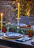 TANYA SOUTHWORTH GARDEN, LONDON, DESIGNER ANOUSHKA FEILER: SMALL GARDEN - TABLE, LIGHTING, EVENING, NIGHT, FORMAL, ENTERTAINMENT, CUTLERY, PLATES