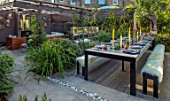 TANYA SOUTHWORTH GARDEN, LONDON, DESIGNER ANOUSHKA FEILER: TABLE, BENCHES, BAMBOOS, CONTAINERS, OUTDOOR LIVING ROOM. SOFAS, FIRE, MIRRORS, RENDERED WALL, SMALL, FORMAL, TOWN, URBAN