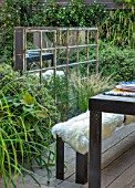 TANYA SOUTHWORTH GARDEN, LONDON, DESIGNER ANOUSHKA FEILER: ANTIQUE MIRROR, TABLE, BENCHES, SMALL, FORMAL, TOWN, URBAN