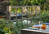 TANYA SOUTHWORTH GARDEN, LONDON, DESIGNER ANOUSHKA FEILER: ANTIQUE MIRROR, TABLE, BENCHES, SMALL, FORMAL, TOWN, URBAN, REFLECTED, REFLECTIONS