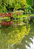 BENNETTS WATER GARDENS, DORSET: LAKE, POND, POOL, SUMMER, RED PAINTED JAPANESE BRIDGE, CHINESE LANTERN, CORNUS CONTROVERSA VARIEGATA, REFLECTIONS, REFLECTED