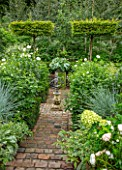 CLAUS DALBY GARDEN, DENMARK: SUNKEN GARDEN, PATIO, TERRACES, BRICK PATH, CARPINUS BETULUS CLIPPED TREES. GREEN, GARDENS, WHITE DAHLIAS, HYDRANGEAS