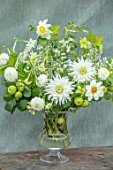 CLAUS DALBY GARDEN, DENMARK: FLOWER BOUQUET IN WHITE AND GREEN BY CLAUS DALBY IN GREY CONTAINER. DAHLIAS, NICOTIANAS, APPLES, ARRANGEMENT