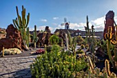 JARDIN DE CACTUS, LANZAROTE, CANARY ISLANDS: DESIGNER CESAR MANRIQUE -  PATH, CIRCULAR CACTUS GARDEN, CANARY ISLANDS, DRY, DROUGHT, TOLERANT, ROCKS, STONES, CACTI. TERRACES