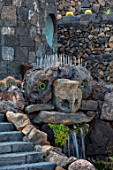 JARDIN DE CACTUS, LANZAROTE, CANARY ISLANDS: DESIGNER CESAR MANRIQUE - FACE IN THE ROCK, WATERFALL, STEPS, VOLCANIC, BLACK, ASH