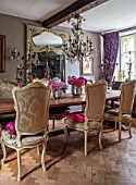 PYTTS HOUSE, OXFORDSHIRE: THE DINING ROOM. DINING TABLE, CHAIRS, CANDELABRAS, MIRROR