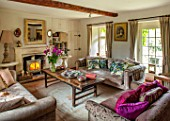 PYTTS HOUSE, OXFORDSHIRE: SITTING ROOM, SOFAS, CUSHIONS, FIREPLACE