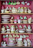 PYTTS HOUSE, OXFORDSHIRE: CABINET IN KITCHEN PAINTED PINK WITH CROCKERY