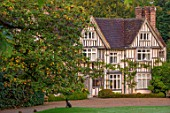 PASHLEY MANOR GARDEN, SUSSEX: THE HOUSE AND MAIN DRIVE IN AUTUMN