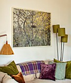 HORSE SHOE BEND, LONDON. DESIGNER MARTHA KREMPEL: LIVING ROOM, SETTEE, CUSHIONS, PHOTOGRAPH OF BIRCH TREES, LAMPS, LIGHTS