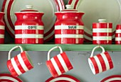 ALHAM FARM, SOMERSET: CORNISHWARE: KITCHEN, DRESSER PAINTED GREEN, PAINT IS SAGE GREEN, RED STRIPE CORNISHWARE