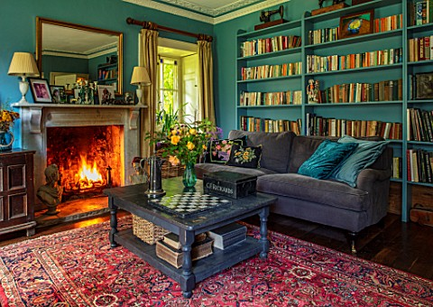 ALHAM_FARM_SOMERSET_CORNISHWARE_SITTING_ROOM_IN_PEACOCK_BLUE_FIRE_BOOKCASE_VELVET_SOFA_ENGLISH_COUNT
