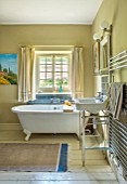 ALHAM FARM, SOMERSET: CORNISHWARE: BATHROOM, REPRO ROLL BATH, PAINTING BY KARINAS GRANDFATHER