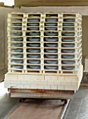 ALHAM FARM, SOMERSET: CORNISHWARE: THE POTTERY - CORNISHWARE BLUE AND WHITE STRIPED BOWLS COMING OUT OF THE KILN