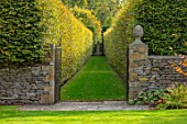 RADCOT HOUSE, OXFORDSHIRE: NORTH SOUTH AXIS OF GARDEN. WALLS, GATES, BEECH AVENUE, LAWNS, PATHS, FINIALS, HEDGES, HEDGING