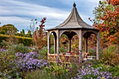 RADCOT HOUSE, OXFORDSHIRE: PAVILION AREA - GAZEBO, PAVILION, SEATING, ASTERS, LATE SUMMER