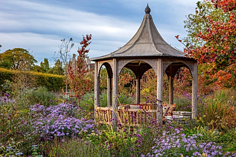 RADCOT_HOUSE_OXFORDSHIRE_PAVILION_AREA__GAZEBO_PAVILION_SEATING_ASTERS_LATE_SUMMER