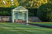 RADCOT HOUSE, OXFORDSHIRE: THE LONG POND. BEECH HEDGES, HEDGING, POOL, CANAL, GAZEBO, SEAT, SEATING, AUTUMN