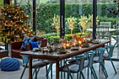 GIBBONS CROFT, WEST CLANDON, SURREY: CHRISTMAS. OPEN PLAN KITCHEN, DINING ROOM. GLASS WALLED EXTENSION, FIREPLACE, WOODEN DINING TABLE, CHAIRS, CHRISTMAS TREE
