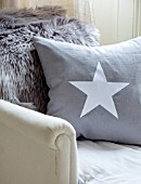 AMANDA KNOX HOUSE GRANTHAM: CHRISTMAS, LIVING ROOM - GREY CUSHION WITH WHITE STAR ON LOUNGER