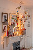 AMANDA KNOX HOUSE GRANTHAM: KITCHEN DINING ROOM, CHRISTMAS, CANDLES, FIREPLACE, DECORATIONS