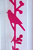 AMANDA KNOX HOUSE GRANTHAM: WHITE AND PINK KITCHEN, CHRISTMAS: PINK BIRD DECORATION ON FRENCH SHUTTERS SCREENING UTILITY ROOM