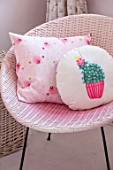 AMANDA KNOX HOUSE GRANTHAM: GIRLS BEDROOM, PINK, WHITE, CHRISTMAS, RATTAN CHAIR, CUSHIONS