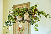 MARBURY HALL, SHROPSHIRE: DESIGNER SOFIE PATON-SMITH - DINING ROOM, VICTORIAN INSPIRED CHRISTMAS, CLOUD DECORATION HANGING FROM CEILING - HOPS, PAMPAS GRASS, HONESTY, EUCALYPTUS