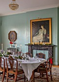 MARBURY HALL, SHROPSHIRE: DESIGNER SOFIE PATON-SMITH - SWEDISH CHRISTMAS, PALE BLUE DINING ROOM, TABLE, RED AMARYLLIS