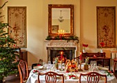 MARBURY HALL, SHROPSHIRE: DESIGNER SOFIE PATON-SMITH - TAPESTRY DINING ROOM, SWEDISH CHRISTMAS - LUNCH SERVED IN HOME MADE STRAW BASKET , CANDLES