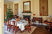 MARBURY HALL, SHROPSHIRE: DESIGNER SOFIE PATON-SMITH - TAPESTRY DINING ROOM, SWEDISH CHRISTMAS - LUNCH SERVED IN HOME MADE STRAW BASKET , CANDLES, CHRISTMAS TREE, MIRROR