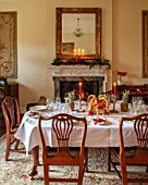 MARBURY HALL, SHROPSHIRE: DESIGNER SOFIE PATON-SMITH - TAPESTRY DINING ROOM, SWEDISH CHRISTMAS - LUNCH SERVED IN HOME MADE STRAW BASKET , CANDLES, MIRROR