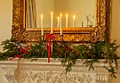 MARBURY HALL, SHROPSHIRE: DESIGNER SOFIE PATON-SMITH - TAPESTRY DINING ROOM, SWEDISH CHRISTMAS -MANTELPIECE WITH CANDLES, MIRROR