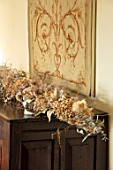 MARBURY HALL, SHROPSHIRE: DESIGNER SOFIE PATON-SMITH - TAPESTRY DINING ROOM, SWEDISH CHRISTMAS - TAPESTRY, DRIED FLOWER GARLAND