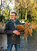 WARDINGTON MANOR, OXFORDSHIRE: FLORIST SHANE CONNOLLY HOLDING HYDRANGEA HEADS