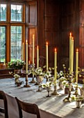 WARDINGTON MANOR, OXFORDSHIRE: FLORIST SHANE CONNOLLY - DINING ROOM: DINING TABLE, WHITE TABLECLOTH, CANDLES, SILVER VASES WITH CHRISTMAS ROSE, HELLEBORES, INDOOR, FLOWERS