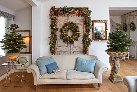 MERRYWOOD_JACKY_HOBBS_HOUSE_LONDON_SITTING_ROOM_VINTAGE_FRENCH_DOORS_SOFA_CUSHIONS_CHRISTMAS_TREES_V